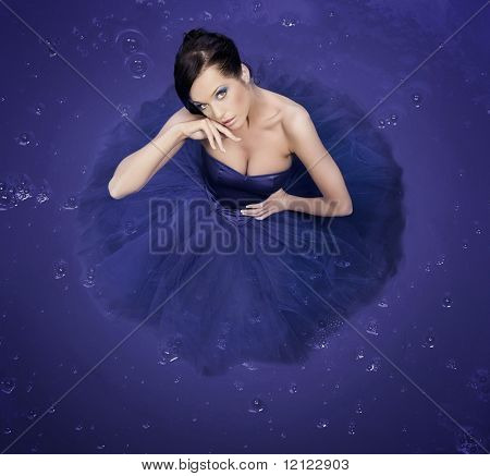 Beautiful girl standing in a big container - color version poster