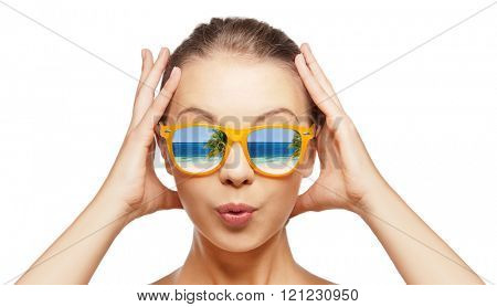 travel, vacation, summer holidays and happy people concept - portrait of amazed teenage girl in sunglasses with beach reflection