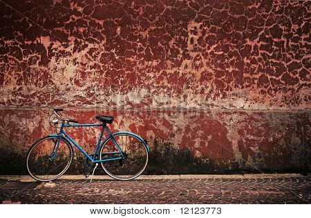 Old retro bicycle over grungy wall
