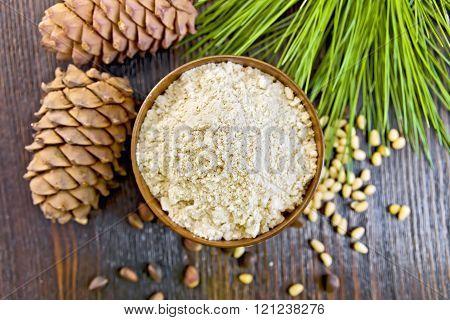 Flour cedar in wooden bowl on board top