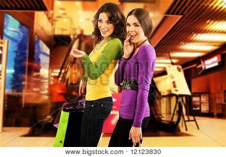 Two beautiful girls in a shopping center