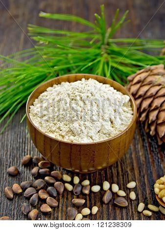 Flour cedar in wooden bowl on board