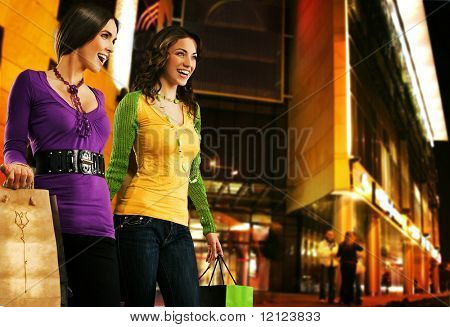 Two beautiful girls over shopping center at the evening
