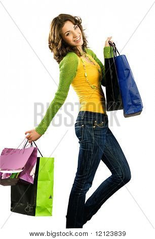 Cute happy girl with shoppingbag isolated on white