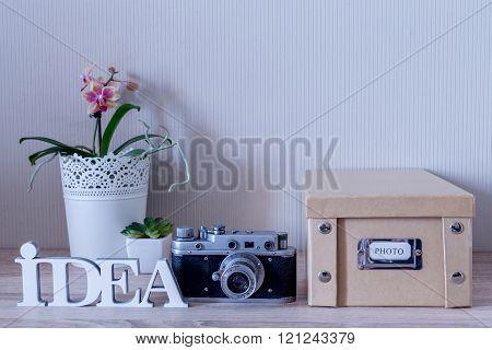 Idea Word With Retro Camera And Photo Album