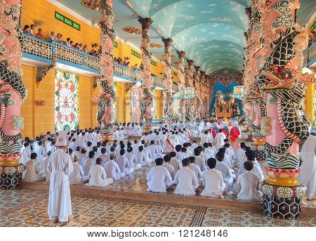Followers Of The Cao Dai Praying In Cao Dai Temple