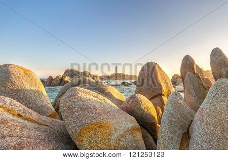 Stone flower Ke Ga lighthouse area with rocks rose as flower-shaped lighthouse in the distance is so beautiful as the flower stigma setting sun in central Vietnam sea