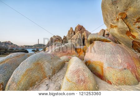 Beauty stone path to the lighthouse in distance with giant boulders as stooping tortoise crawled out towards the lighthouse to create vivid images in landscape wilderness