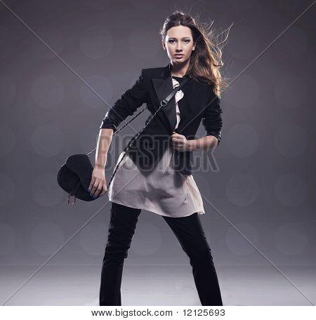 Elegant lady holding handbag, plenty of copyspace