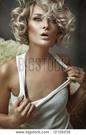 Vogue style portrait of a young blond beauty