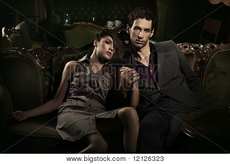 Handsome couple sitting on sofa