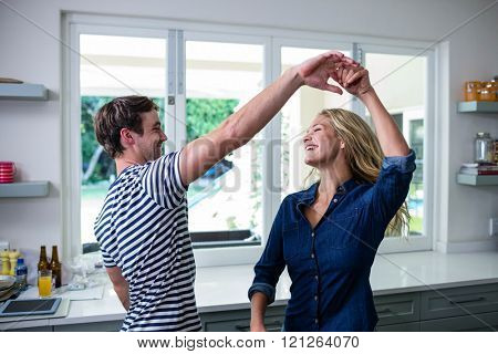 Cute couple dancing in the kitchen