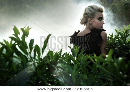 Fashionable blonde posing at twillight