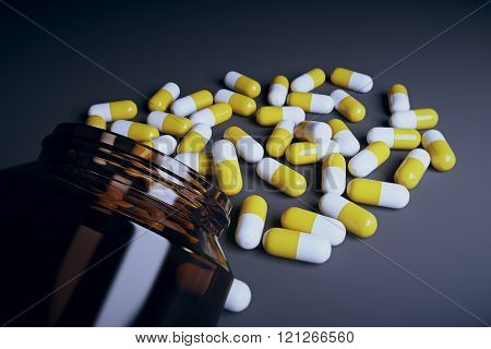 Brown Glass Bottle And Pills On Black Table, Close Up