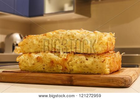 macaroni and cheese on a wooden board