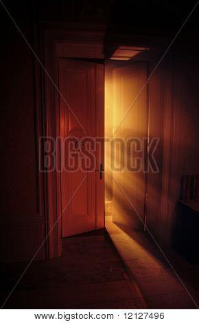 Heavenly rays of light behind the door