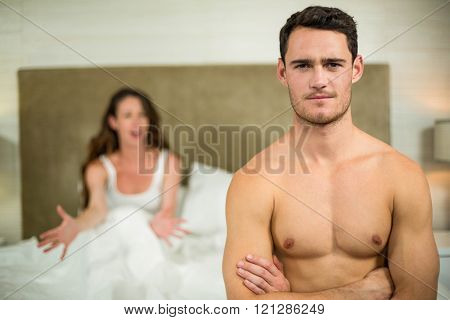 Upset couple having an argument in the bedroom