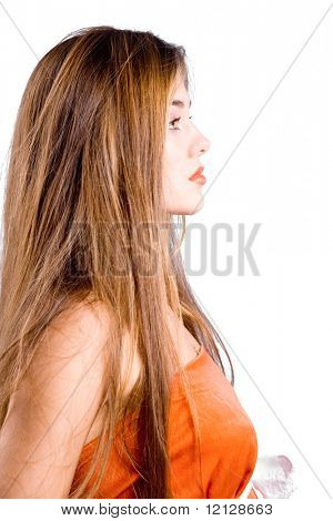 Profile of young beautiful girl with long hair isolated on white