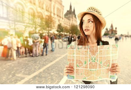 Traveler with map on stret, outdoors