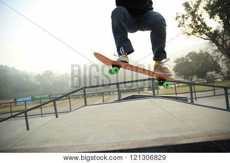 one young skateboarder skateboarding at skate park