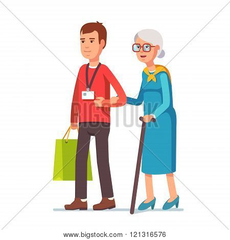 Man social worker helping elder grey haired woman