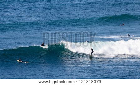 Surfers Ride The Waves In Victoria