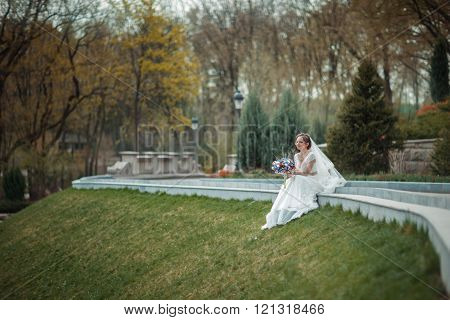 Bride With Bouquet In The Park