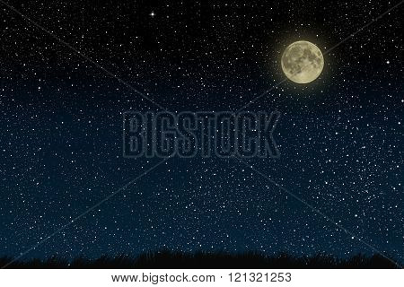 Beautiful magic blue night sky with clouds and fullmoon and stars and grass