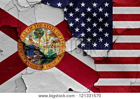 flags of Florida and USA painted on cracked wall poster