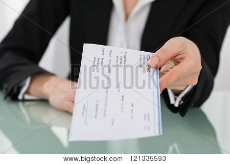 Businesswoman Hand Giving Cheque