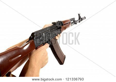 AK-47 automatic machine gun isolated over white, held in hands