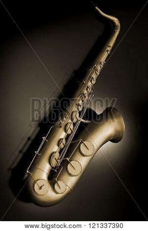 Golden saxophone scale model isolated over black