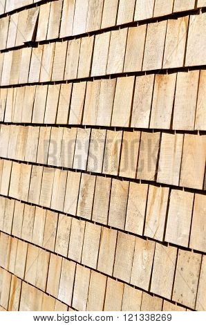 Wooden roof plates background texture. Wooden tiles on roof.