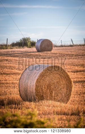 Haystacks On A Field