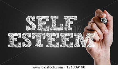 Hand writing the text: Self Esteem