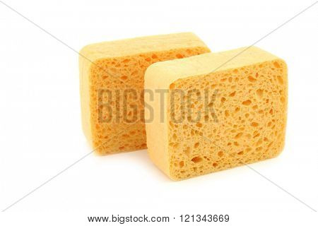 yellow household sponges on a white background