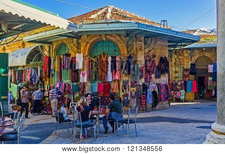 JERUSALEM ISRAEL - FEBRUARY 16 2016: The stalls of the Aftimos Suq offers the colorful eastern clothes and interesting souvenirs on February 16 in Jerusalem.