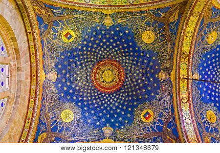 JERUSALEM ISRAEL - FEBRUARY 16 2016: The bright blue dome in Church of All Nations showing the night sky over Gethsemane garden with the old olive trees in corners on February 16 in Jerusalem.