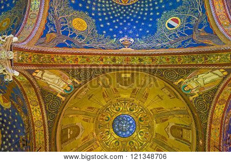 JERUSALEM, ISRAEL - FEBRUARY 16, 2016: All the ceiling in Church of All Nations is covered by colorful mosaics, depicting the night sky over Gethsemane garden and the Evangelists and angels, on February 16 in Jerusalem.