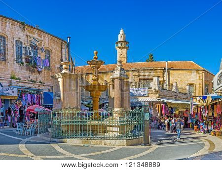 JERUSALEM ISRAEL - FEBRUARY 16 2016: The Muristan Square is the heart of the noisy Aftimos Suq with its interesting stalls and cozy cafes on February 16 in Jerusalem.