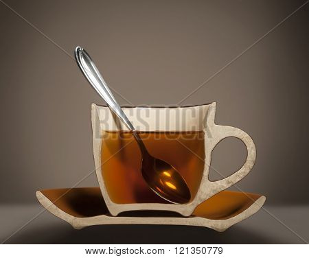 dissected half cup with tea and spoon
