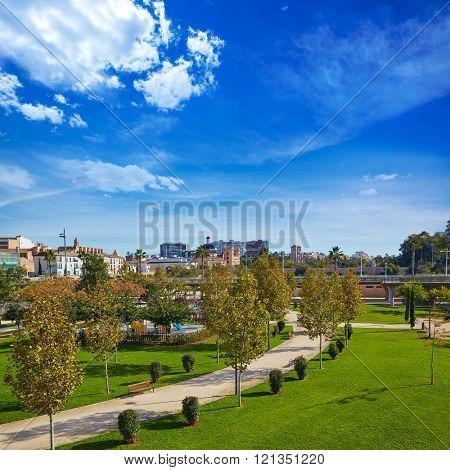 Valencia Turia river park gardens and skyline in Spain