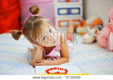 Little girl playing with toys in her nursery