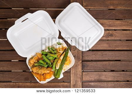 Convenient but unhealthy polystyrene lunch boxes with take away meal