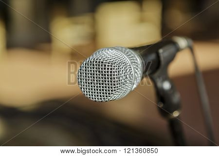Nice amazing  view of microphone detailed head against blurred outdoor background