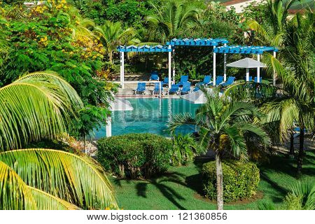 Cayo Coco island, Memories Caribe Beach Resort, Cuba, Aug. 31, 2015, beautiful amazing view of swimming pool in tropical palm tree garden