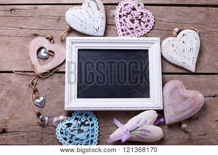 Empty Blackboard And Decorative  Hearts On  Vintage Wooden Background.