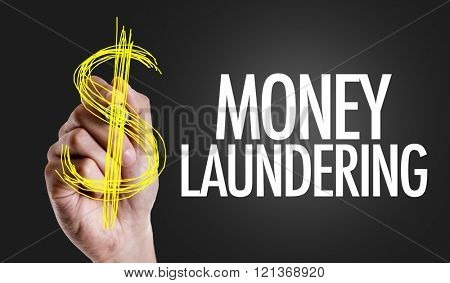Hand writing the text: Money Laundering