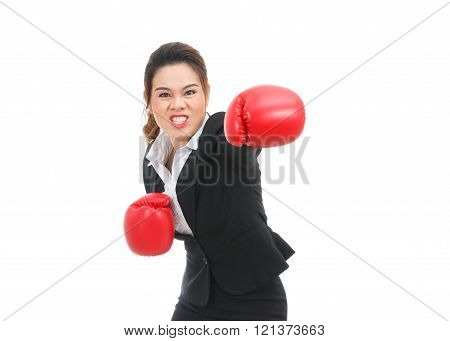 Asian business woman with boxing gloves punching isolated on white background