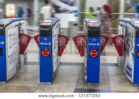 KUALA LUMPUR MALAYSIA - JANUARY 10 2016: People at KL Sentral Station exit. KL Sentral is a major transport hub of Kuala Lumpur opened in 2001.